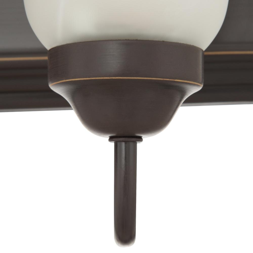 Bath light with a rustic oil-rubbed bronze finish