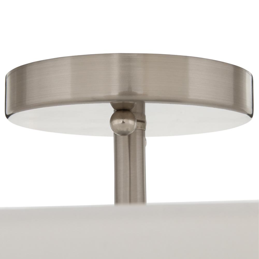 Flush mount light featuring a sophisticated brushed nickel finish