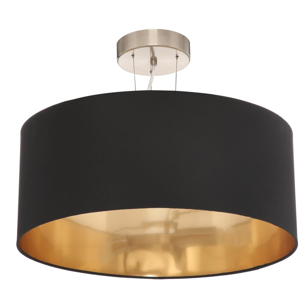 Pendant light drum shade featuring a black fabric and gold lining