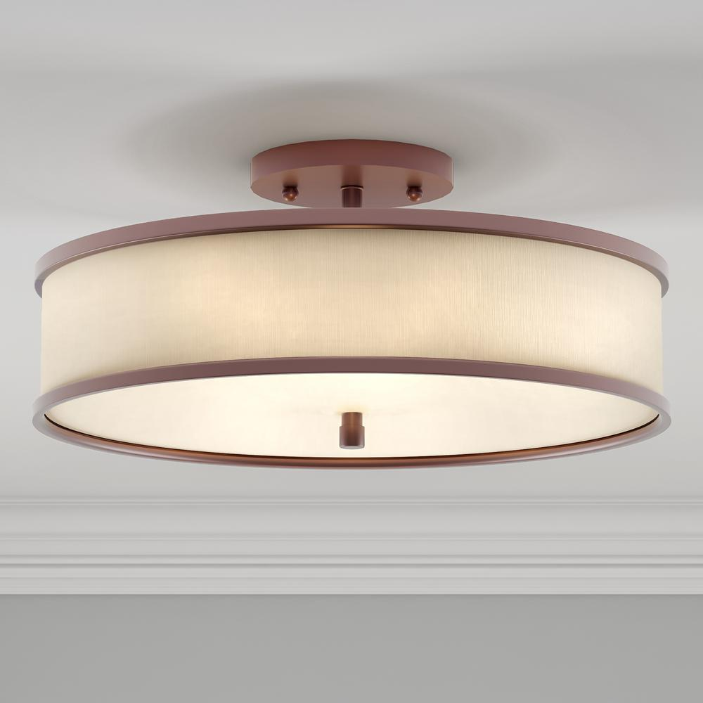 Flush mount light featuring a traditional bronze finish