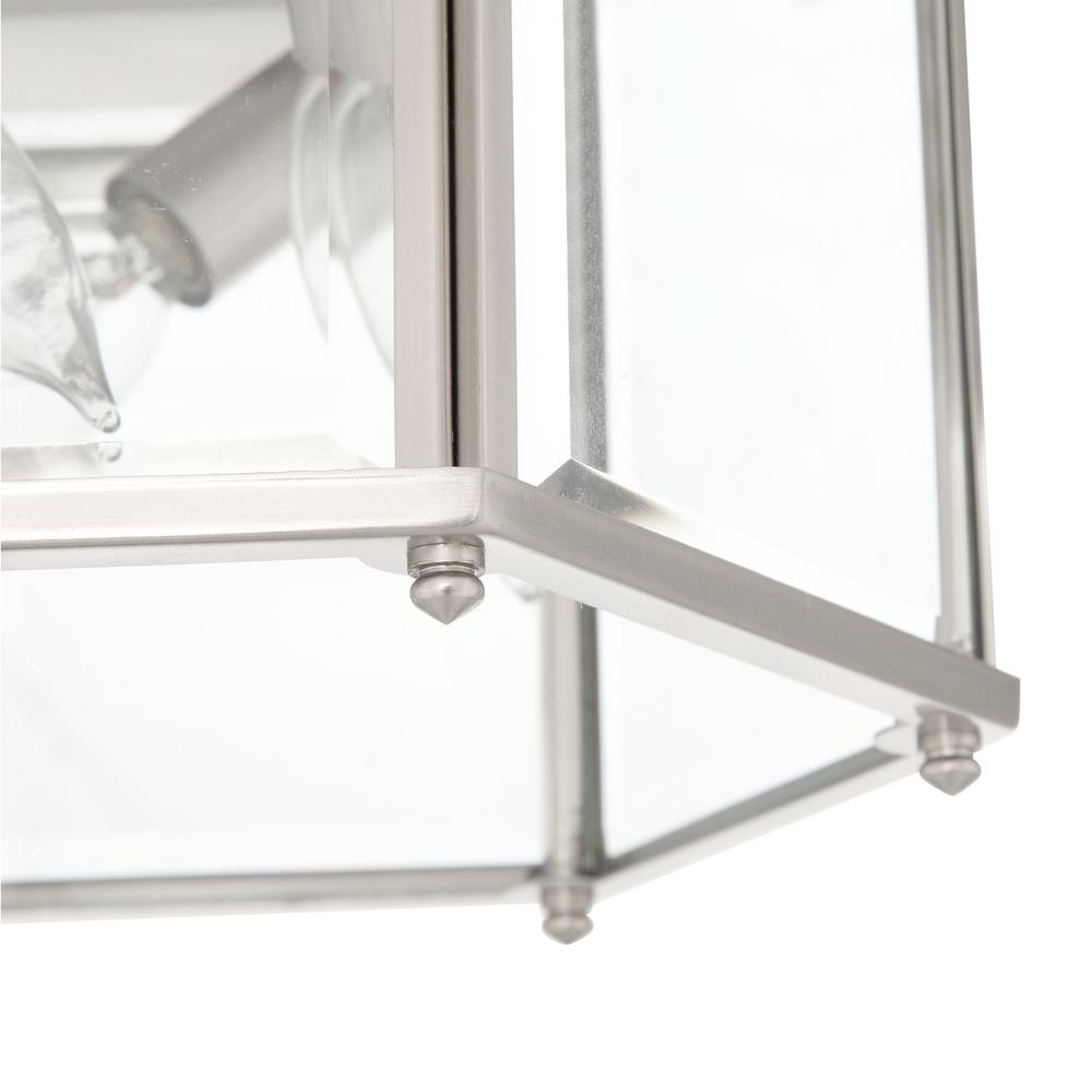 Flushmount light designed for use with three candelabra bulbs