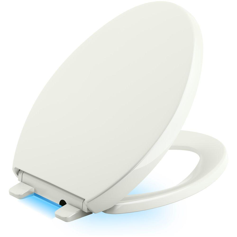 Reveal LED Nightlight Elongated Closed Front Toilet Seat in Dune