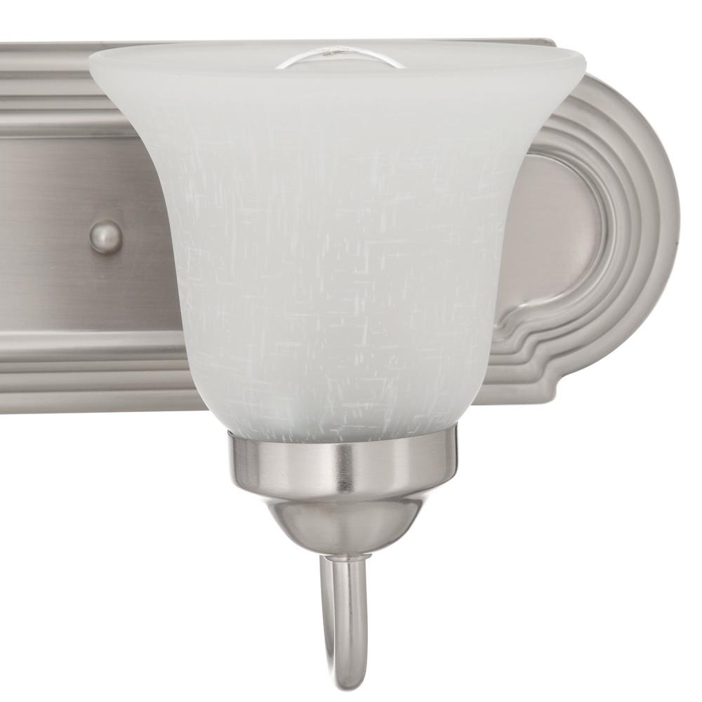 Vanity light featuring glass bell shades