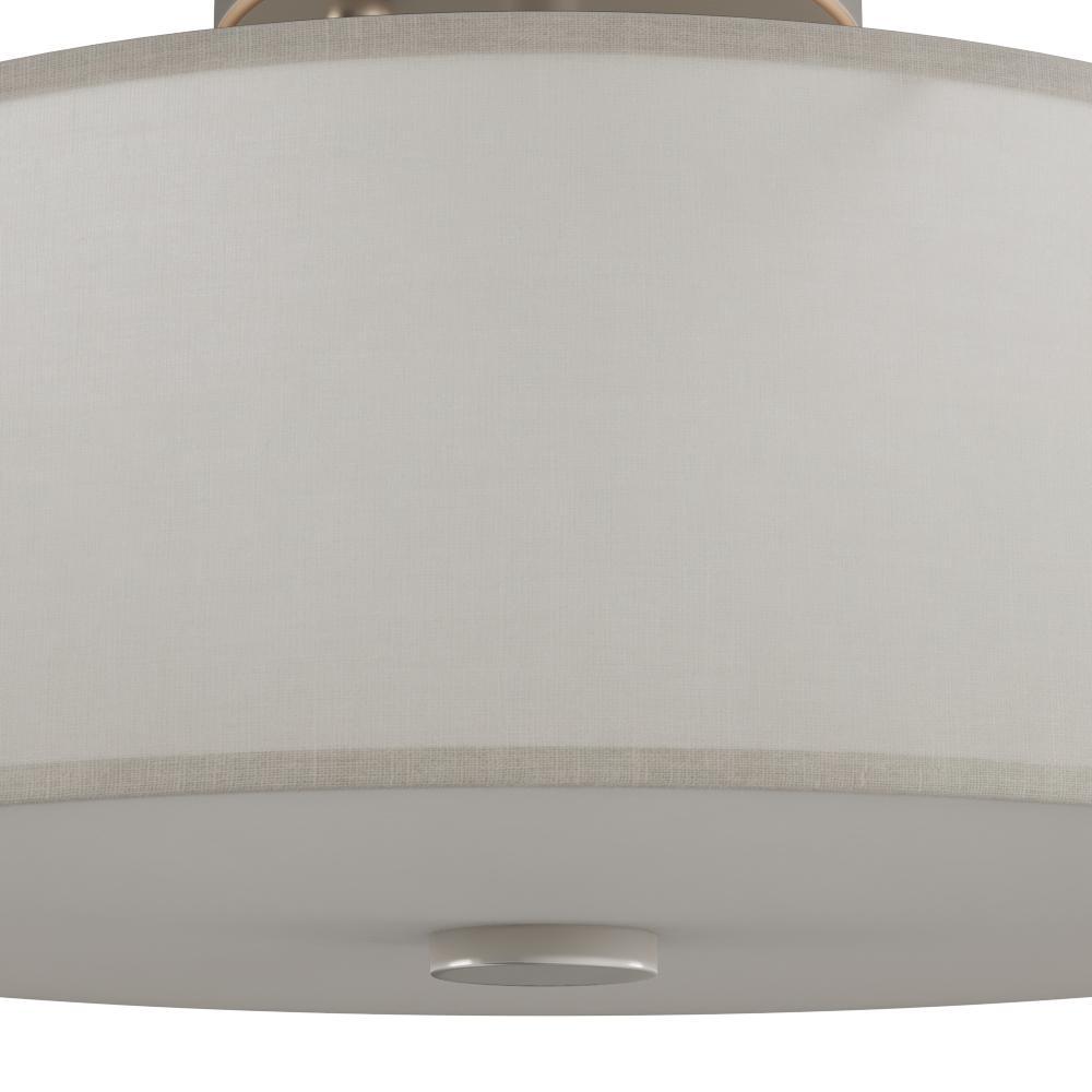 Flush mount light featuring an off-white hardback shade