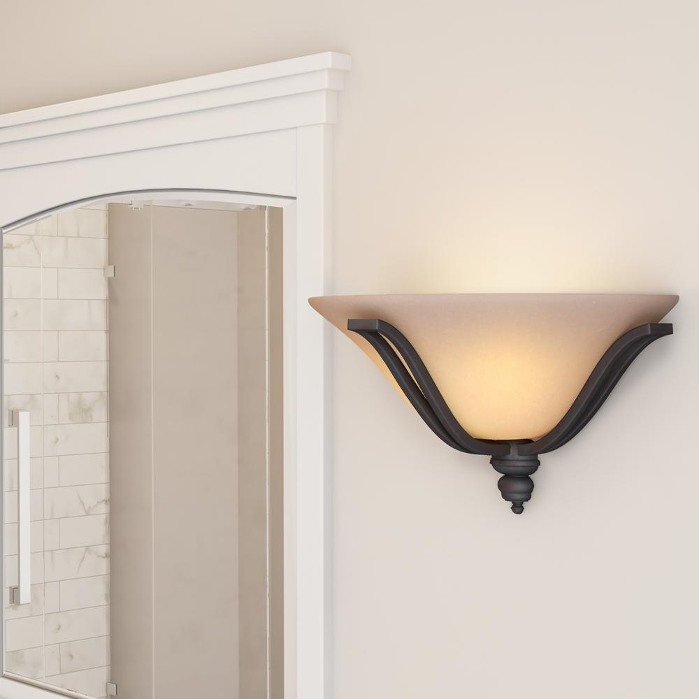 Wall sconce featuring an oil-rubbed bronze finish