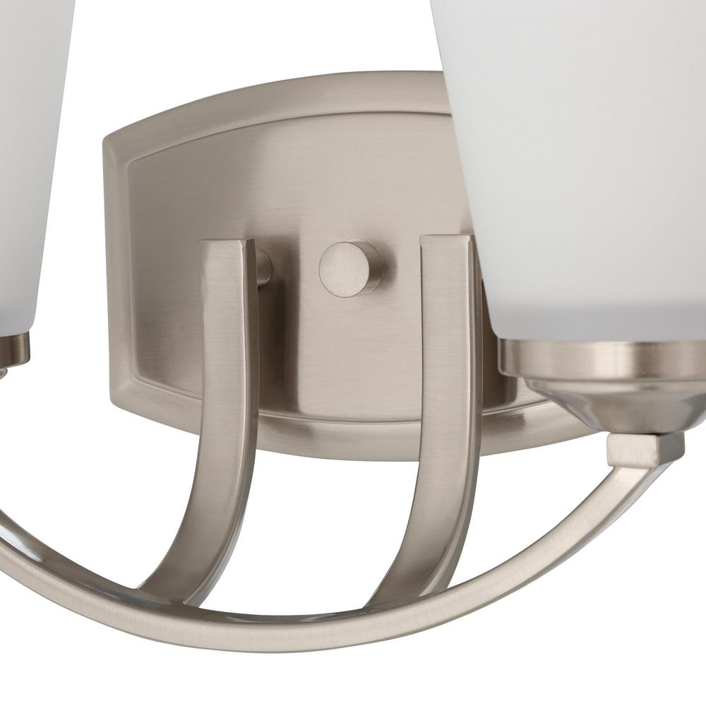 Brushed nickel finish over durable metal accentuates arched details