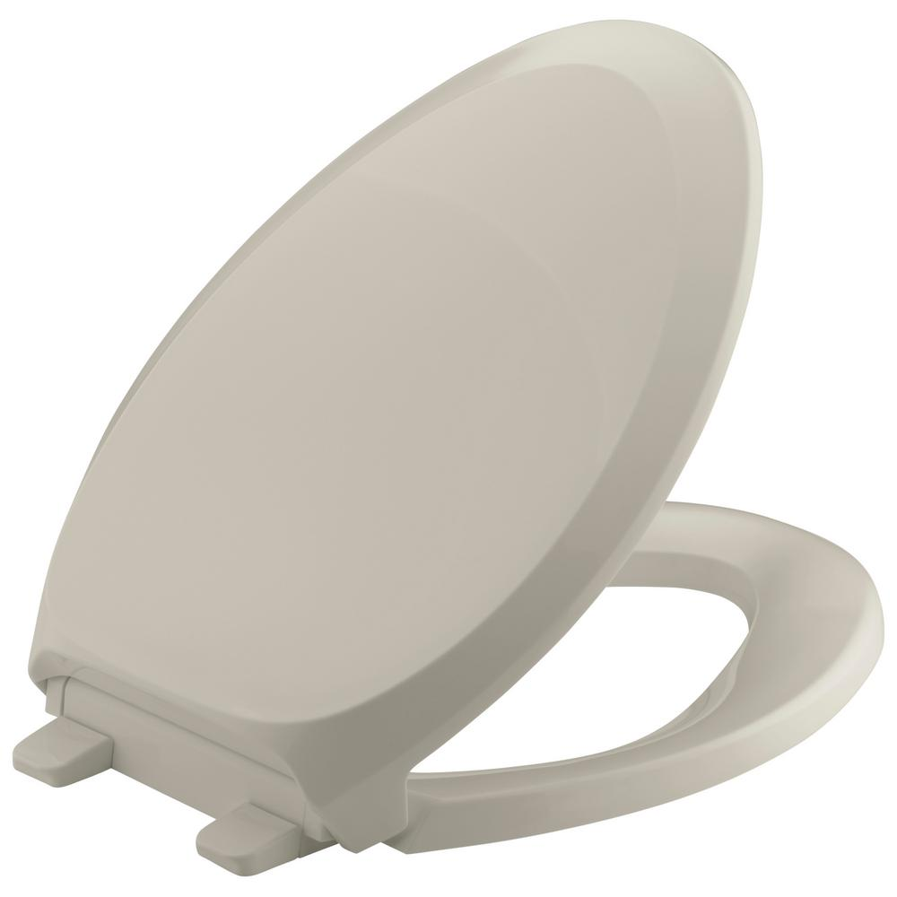 KOHLER French Curve Quiet-Close Elongated Toilet Seat with Grip-tight Bumpers in Sandbar
