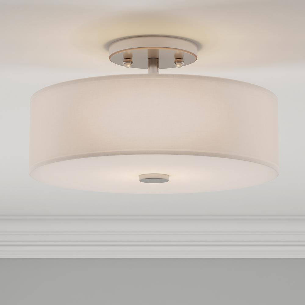Flush mount light with a contemporary brushed nickel finish
