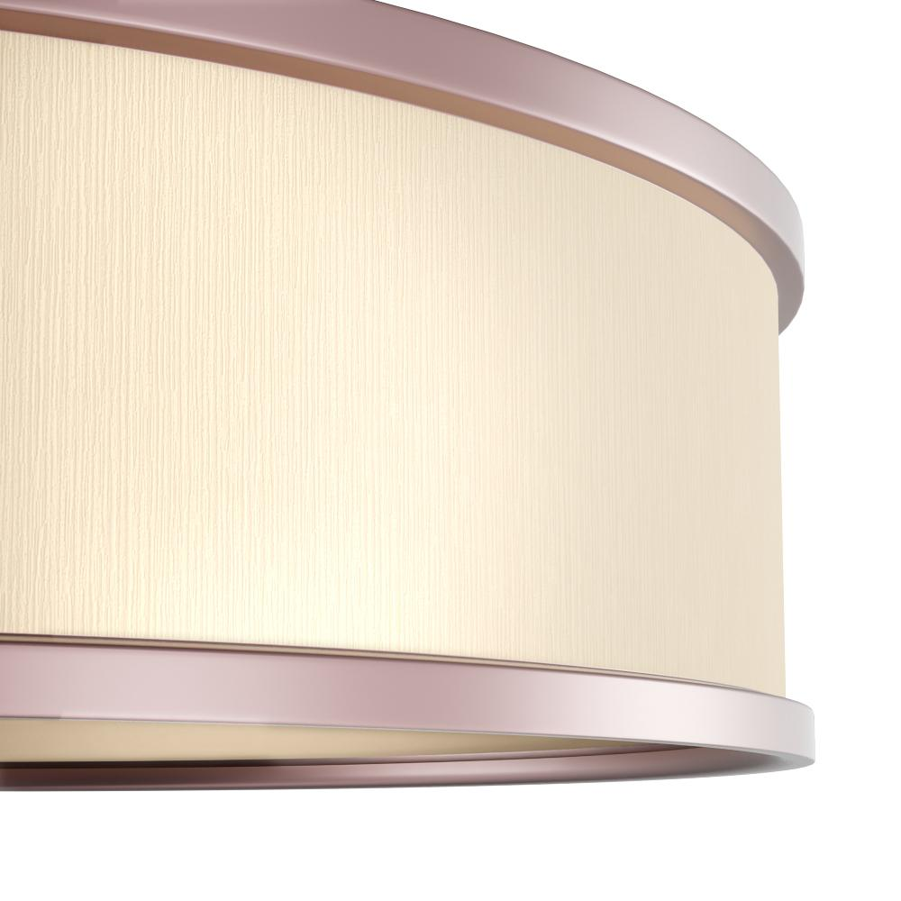 Flush mount light featuring a champagne drum shade