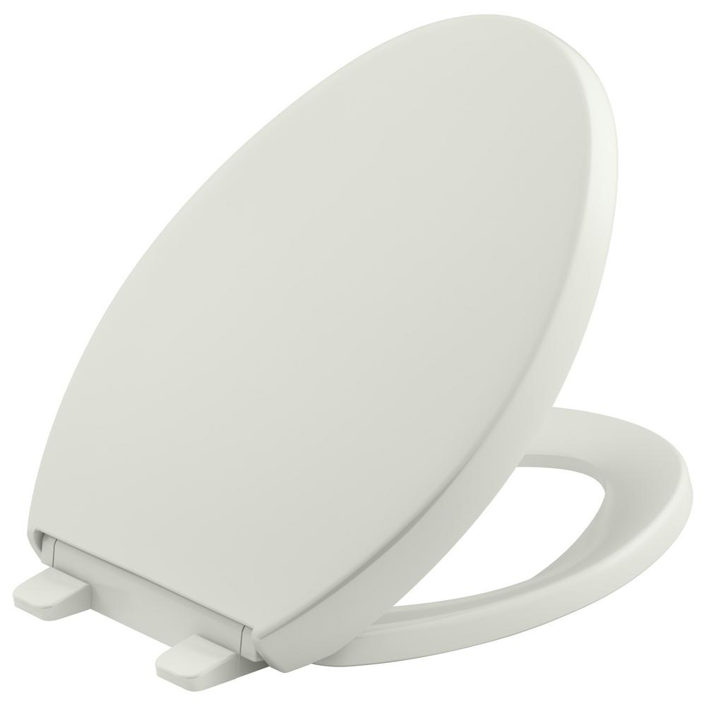 KOHLER Reveal Quiet-Close Elongated Closed Front Toilet Seat with Grip-tight Bumpers in Dune