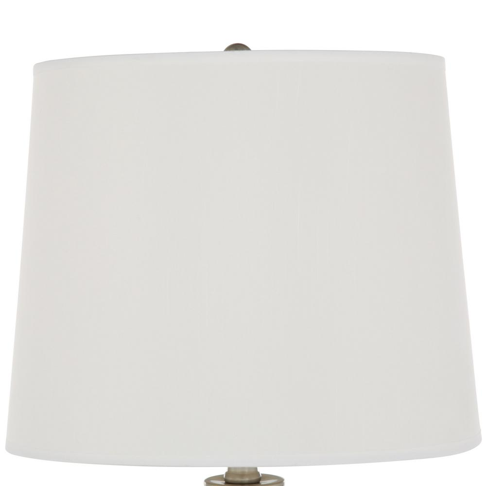 Simple white linen shade completes the lamp design