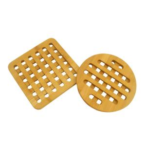Click here to buy Home Basics Bamboo Trivet Set by Home Basics.