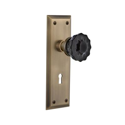 Nostalgic Warehouse New York Plate Interior Mortise Crystal Black Glass Door Knob in Antique Brass