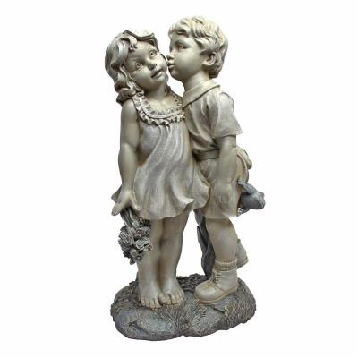 Design Toscano Boy Kissing Girl Surprise 11 In. W x 7 In. D x 22 In. H Garden Statue-DISCONTINUED