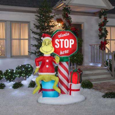 6 ft. Pre-lit Inflatable Airblown Grinch with Santa Stop Here Sign Scene