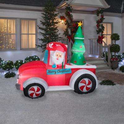7 ft. Pre-Lit  Life Size Airblown Inflatable Santa in Vintage Truck Scene