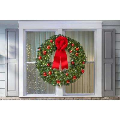 48 in. Pre-Lit LED Artificial Christmas Wreath with red ornaments and a velvet bow