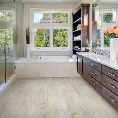 Outlast+ Snowbird Walnut 10 mm Thick x 5-1/4 in. Wide x 47-1/4 in. Length Laminate Flooring (13.74 sq. ft.)