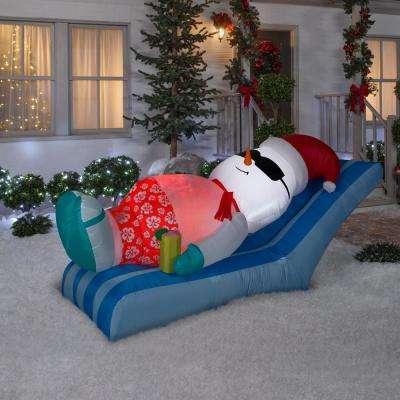 4 ft. Pre-Lit Inflatable Snowman on Beach Chair Scene
