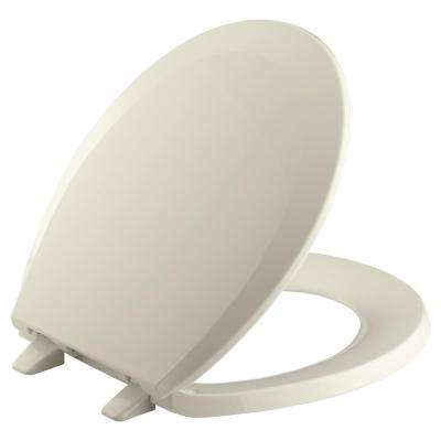 Lustra Round Closed-Front Toilet Seat with Quick-Release Hinges in Almond
