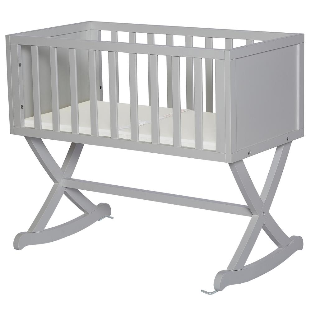 Dream On Me Haven Pebble Grey Cradle Dream On Me Haven cradle creates a cozy nest-like surrounding for your newborn. This cradle offers a simple and modern design by incorporating straight lines, a solid side panel with soft mattress pad and a x-cross base which allows parents to gently rock their babies to sleep. The Haven is essential to a chic loft nursery by just adding neutral tones combined with gold accents, sophisticated iron decors and pops of geometric prints which inspires a plush, peaceful, all-night comfort. Color: Pebble Grey.