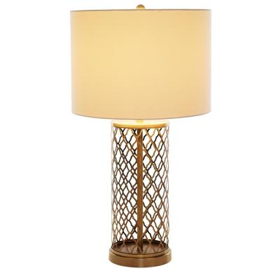26 in. Antique Brass Laser Cut Table Lamp with White Linen Shade