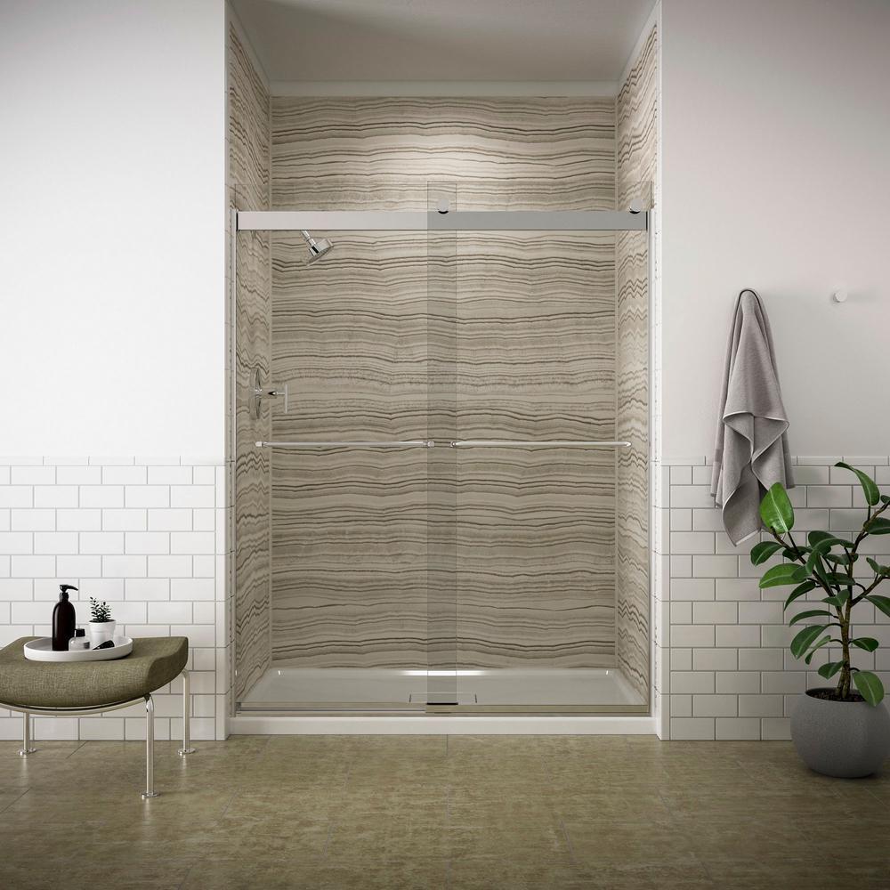 frameless sliding shower door in silver finish with