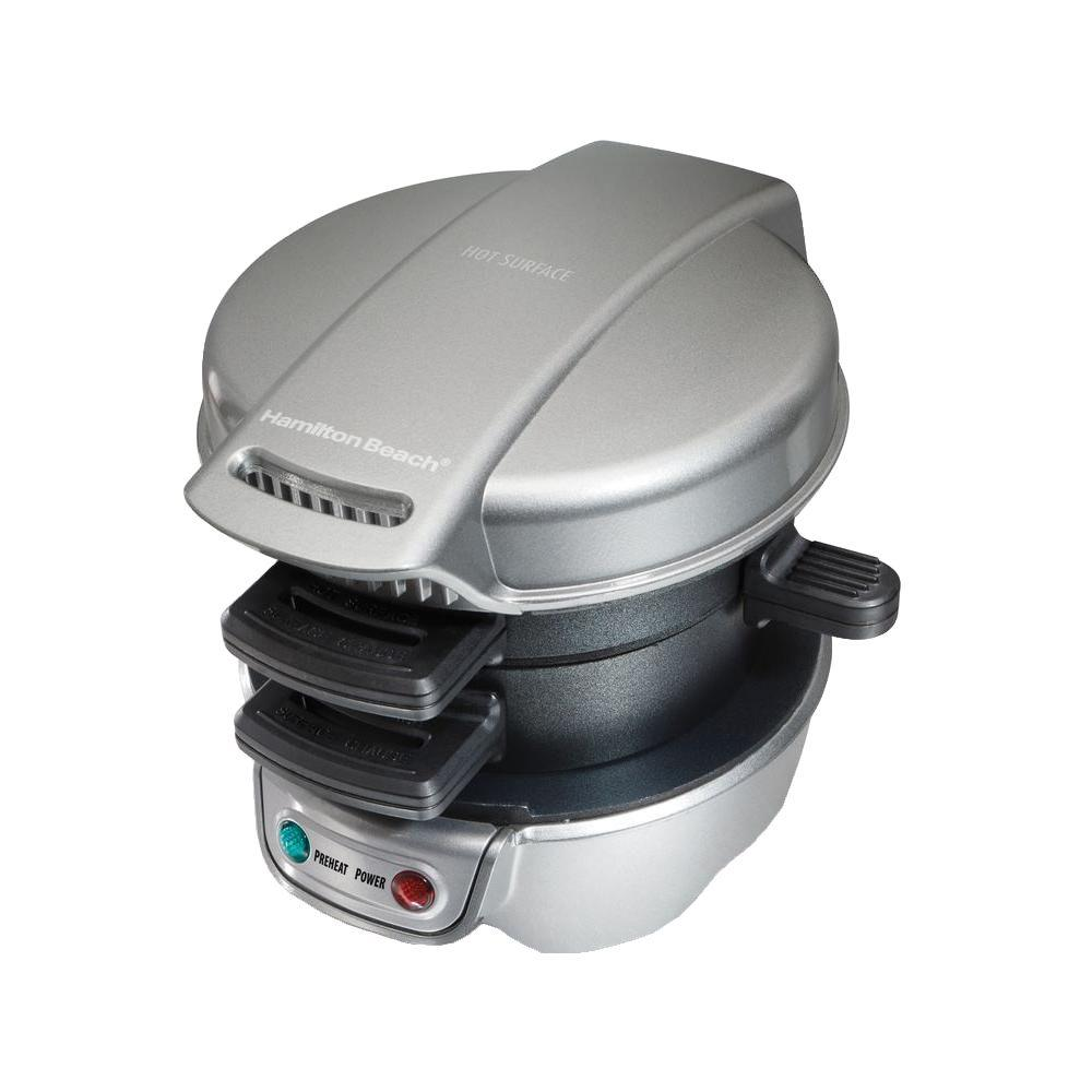 Hamilton Beach Breakfast Sandwich Maker, Silver Forget the fast food drive-through. With the Hamilton Beach Breakfast Sandwich Maker, you can enjoy a hot, homemade breakfast sandwich in under 5 minutes. Simply place the ingredients inside, build the base of your sandwich in the bottom layer, place the egg on the cooking plate and close the lid. Slide the cooking plate out and your sandwich assembles itself. Open the lid and your hot breakfast sandwich is ready to eat. Color: Silver.