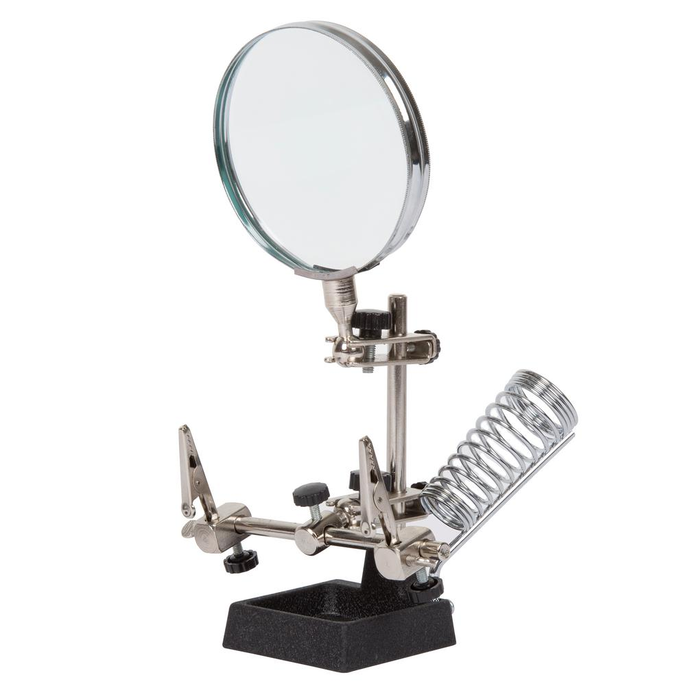 Stalwart 3.5 in. 2X Helping Hand Magnifier with Stand Designed with the hobbyist, electrician, jeweler and everyday user in mind, the Helping Hand 3.5 in. Magnifier is the perfect solution for anyone doing detailed work. The 2 adjustable clips will hold your work firmly in position, freeing up your hands for soldering, gluing and other tasks. The 2X magnifier acts as a great visual aid. The heavy-duty base provides stability while working. (Disclaimer: Magnifications are approximates and may vary slightly.)The powerful 3.5 in. 2X magnifying glass will give you a close up view of the details of your work so that you can get the job done accurately.