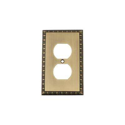 Egg and Dart Switch Plate with Outlet in Antique Brass