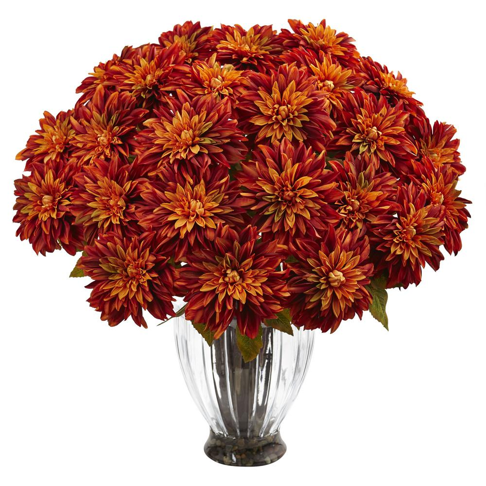 Nearly Natural Silk Dahlia Floral Arrangement Measuring 27 in. tall, this arrangement of Dahlias is the perfect lush centerpiece for the dining room or kitchen. With deep, rich hues of color on each petal, this hand crafted arrangement embodies the true Dahlia flower, native to Mexico, and bursting with warm tones of red, yellow, orange and purple.