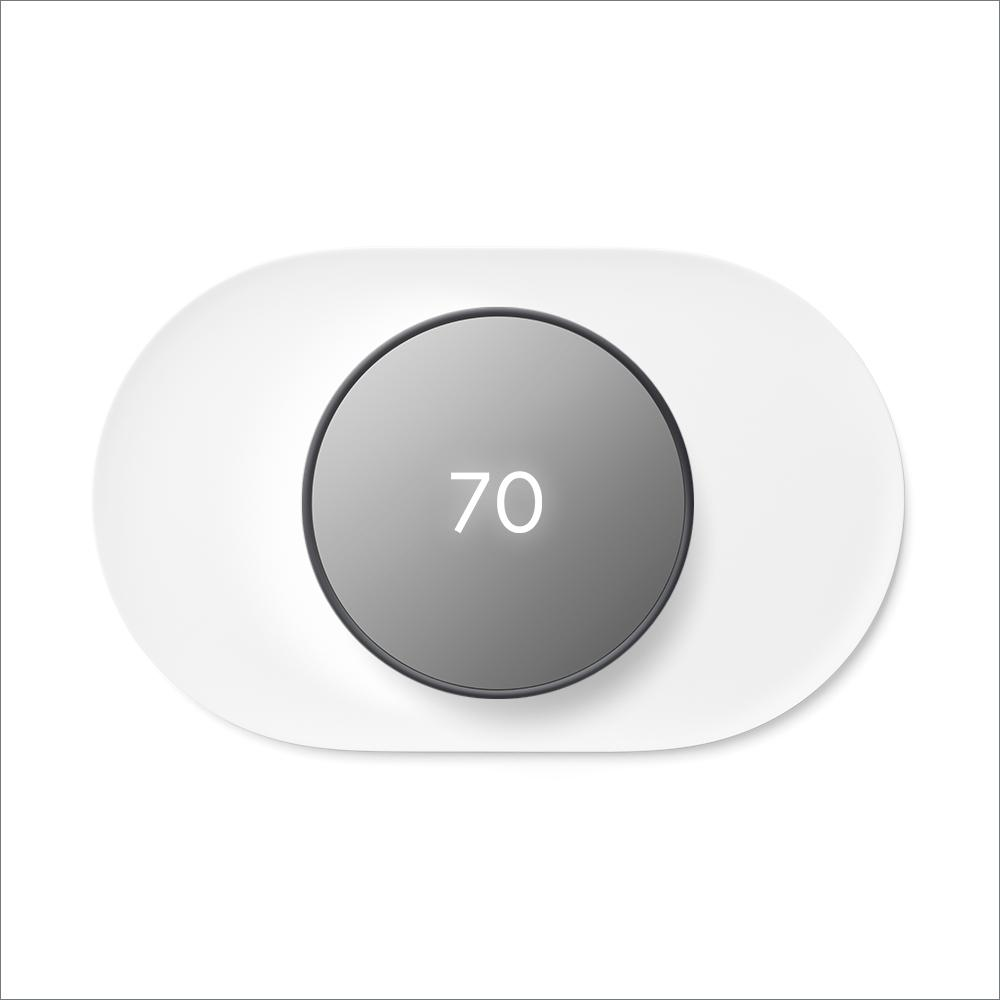"""Google Nest Thermostat Charcoal + Nest Thermostat Trim Kit Snow, Grey Pair a Google Nest Thermostat with the Nest Thermostat Trim Kit for a perfect match. The Nest Thermostat is the helpful thermostat with a cozy price. It can turn itself down to save energy when you leave the house. You can control it from anywhere with the Google Home app – whether you're on an errand or on vacation. You can even change the temperature without getting off the couch or out of bed. Just say, """"Hey Google, turn up the heat.""""1 The Nest Thermostat Trim Kit is designed to cover imperfections on the wall from removing your old thermostat. Color: Charcoal."""