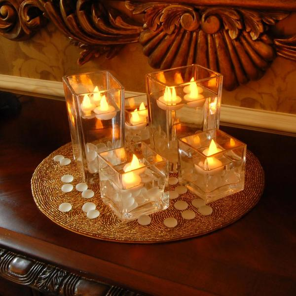 Lumabase 1 25 In X 1 25 In X 1 25 In Amber Floating Led Tea Light Candle 12 Count 55112 The Home Depot