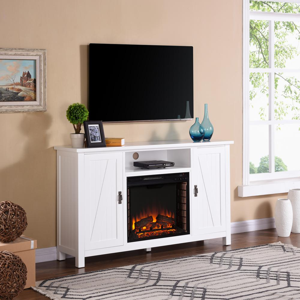 Enjoy country living without leaving the city. This fireplace TV stand brings the charm of the simple life into your busy routine. Entertainment center fireplace with an open media shelf holds your electronic