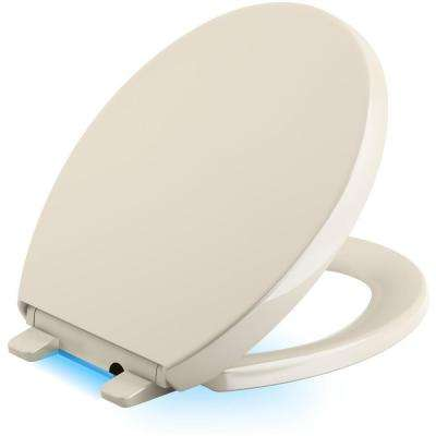 Reveal LED Nightlight Round Closed Front Toilet Seat in Almond