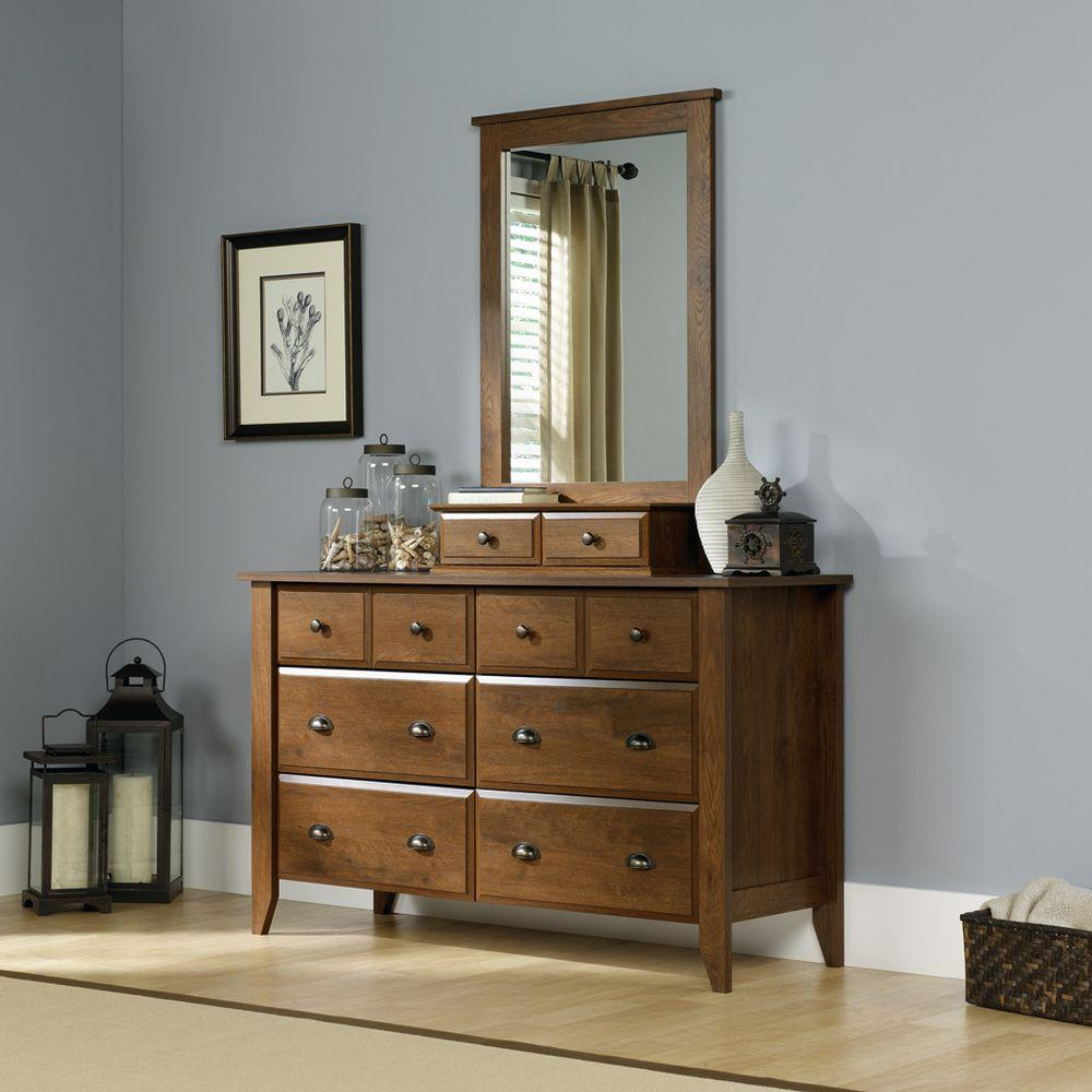 SAUDER Shoal Creek Collection 42.3 in H x 27.4 in. W Oiled Oak Framed Mirror with Storage Drawers