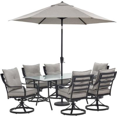 Lavallette 7-Piece Steel Outdoor Dining Set with Silver Linings Cushions, Swivel Rockers, Table, Umbrella and Base