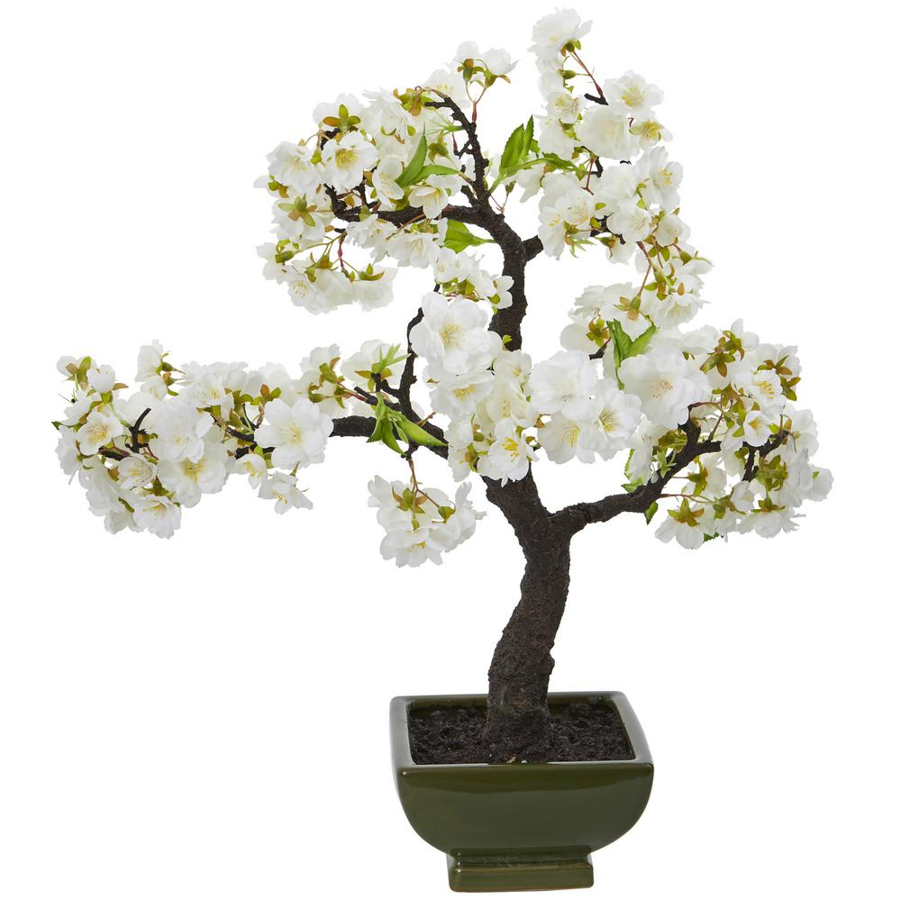 Nearly Natural Cherry Blossom Bonsai Artificial Tree A truly beautiful specimen symbolizing the botanical beauty of Japan. This Cherry Blossom Bonsai is perfect for those seeking elegance and tranquility. The clean, white color brings a sense of peace to all who behold its splendor. Since its maintenance free, you never have to worry about the painstaking upkeep needed with other bonsai. Situated in a elegant pot, the artificial cherry blossom tree makes just about everyone think of spring.