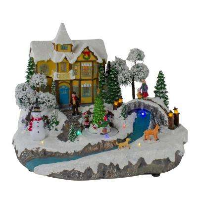 15 in. LED Lighted Yellow Cottage Christmas River Scene with Movement and Music