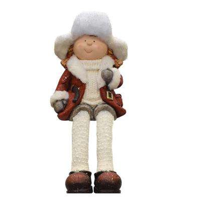 19 in. Sitting Young Girl in Faux Fur Trapper Hat Christmas Figure