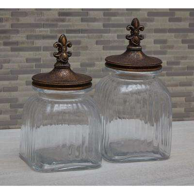 Large: 15 in; Medium: 13 in; Small: 11 in. Old World Glass and Polystone Fleur De Lis Canisters (Set of 3)