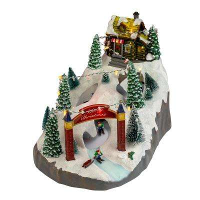9 in. H x 15 in. W LED Animated and Lighted Christmas Scene With 3 Turning Skiers