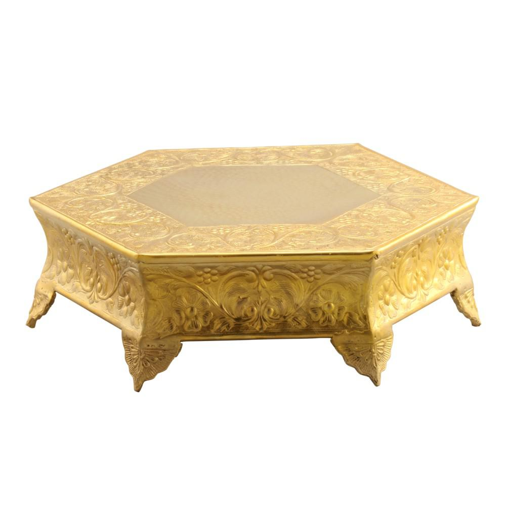 Hexagonal 14 in. Gold Metal Wedding Cake Stand Beautiful en-carved wedding cake stand with hammered center makes a prominent and great inclusion to your kitchen and dining spaces. It is made of aluminum and features a shinny gold finish, giving this cake stand an imperial look. The unique style of this cake stand, compliments cakes of different shapes and sizes. You can even use this stand for showcasing wedding cake, birthday cake or for any theme party.