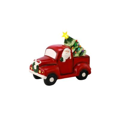 8in Porcelain Santa Pickup in Green