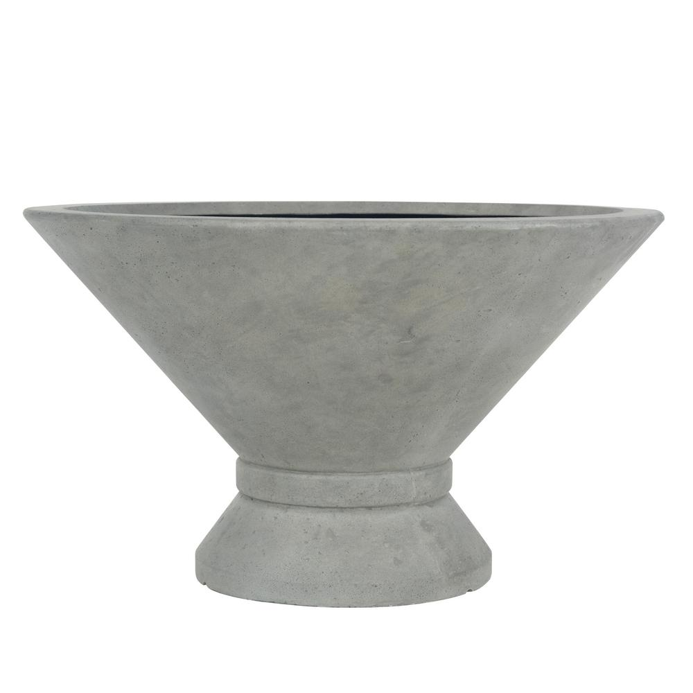 MPG 14 in. H Cast Stone Low Wide Wet Cement Urn with Band This exclusive modern low urn is perfect for urban gardens. Though it looks like cement, it does not have the weight of cement. Constructed of a blend of natural stone, resin and fiberglass, it is Freeze resistant and will age like natural stone. It is lightweight and easy to move. Color: Wet Cement.