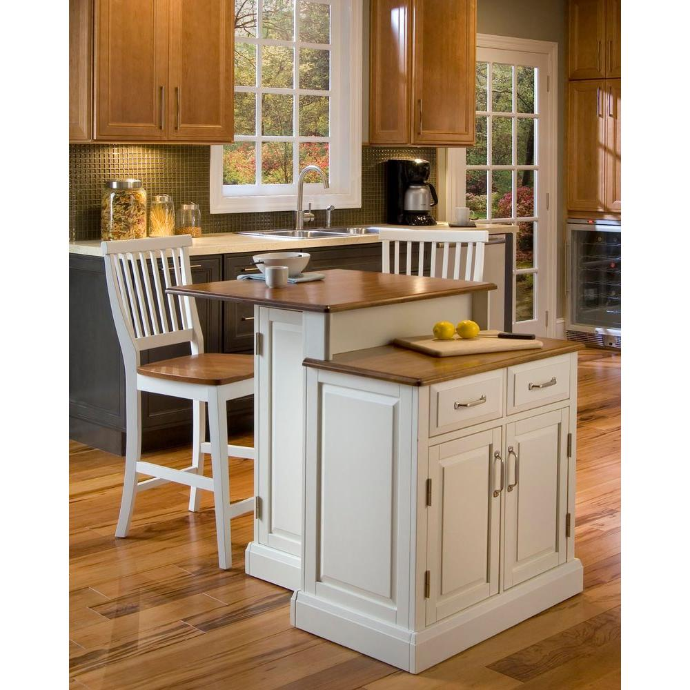 Home styles woodbridge white kitchen island with seating for Kitchen island with drawers and seating