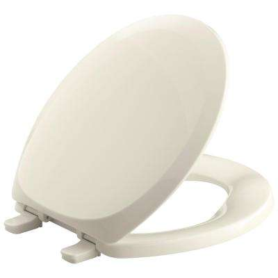 French Curve Round Closed Front Toilet Seat in Almond