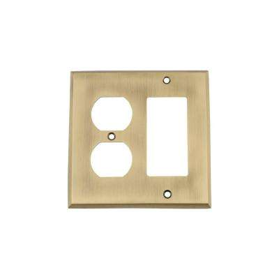 New York Switch Plate with Rocker and Outlet in Antique Brass