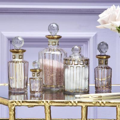 Gold Trimmed Clear Glass Vanity Set Includes: 1-Canister with Lid and 4-Perfume Bottles with Lids (Set of 5)