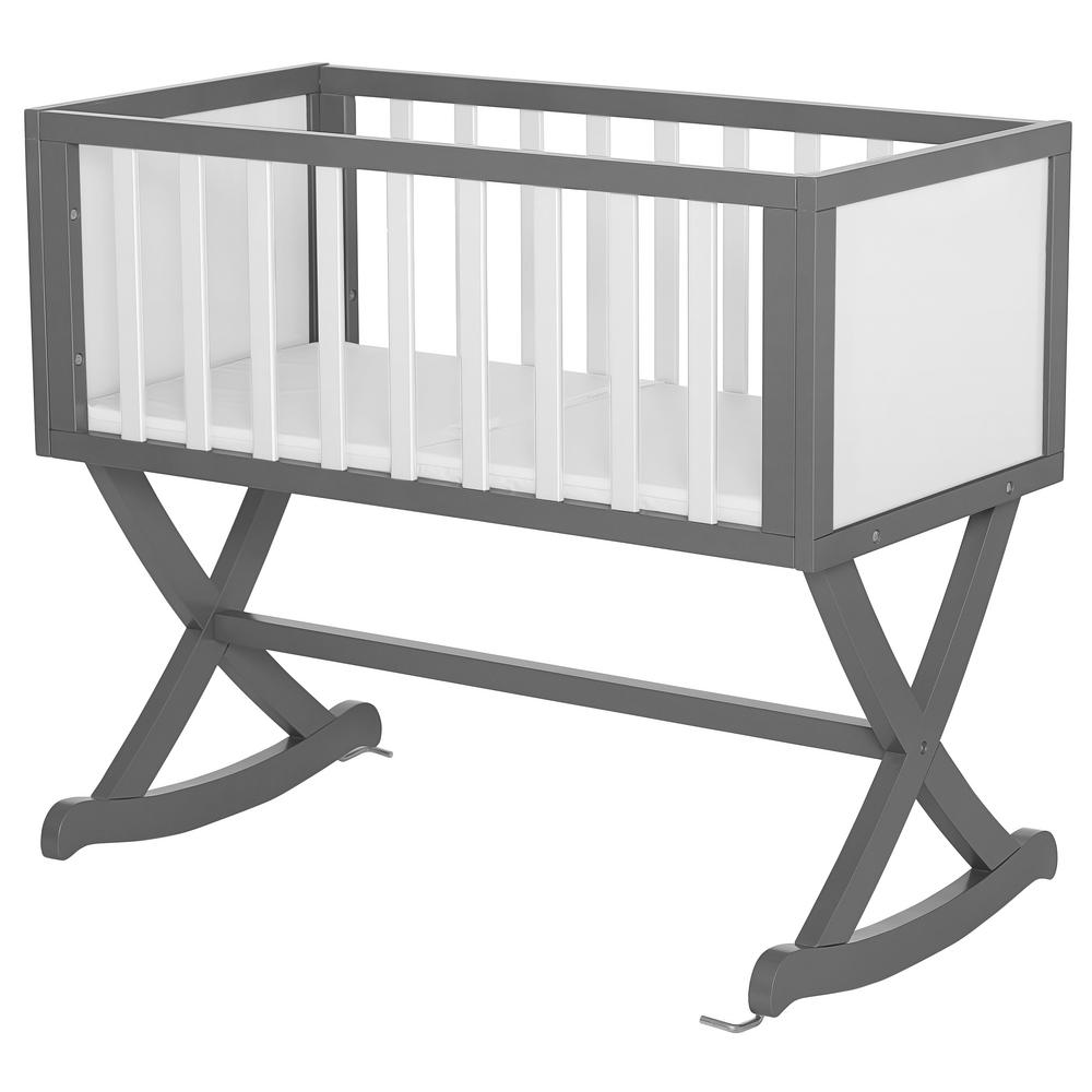 Dream On Me Luna Grey and White Cradle Dream On Me Haven cradle creates a cozy nest-like surrounding for your newborn. This cradle offers a simple and modern design by incorporating straight lines, a solid side panel with soft mattress pad and a x-cross base which allows parents to gently rock their babies to sleep. The Haven is essential to a chic loft nursery by just adding neutral tones combined with gold accents, sophisticated iron decors and pops of geometric prints which inspires a plush, peaceful, all-night comfort. Color: Grey and White.